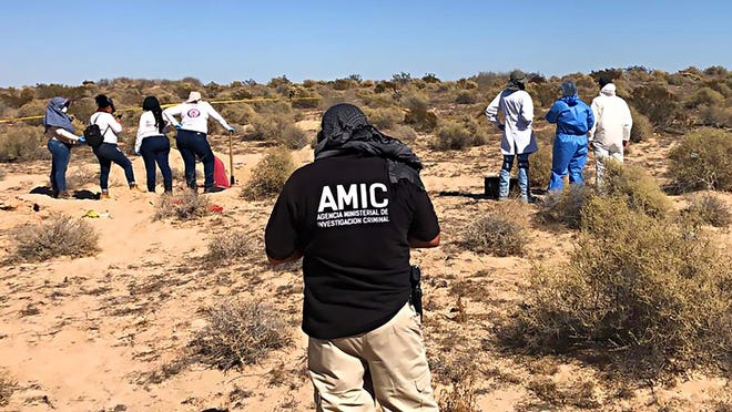 Women with the Mexican group Searching Mothers of Sonora, joined by state investigators, dig up a mass grave with the remains of 13 people on Oct. 24, 2019, outside the popular beach town of Rocky Point.