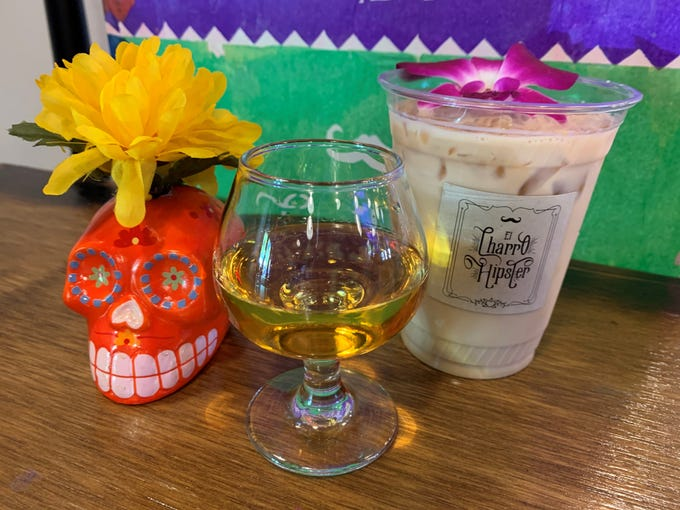 Araceli, a golden liqueur as bright as its ingredients, is made from marigold flowers, a symbol associated with Dia de los Muertos.