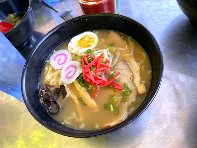 Tokyo shoyu ramen with soy sauce base broth, pork belly chashu, naruto, bamboo shoots, sauteed cabbage and bean sprouts, egg and scallion at Yatai Ramen in Tempe.