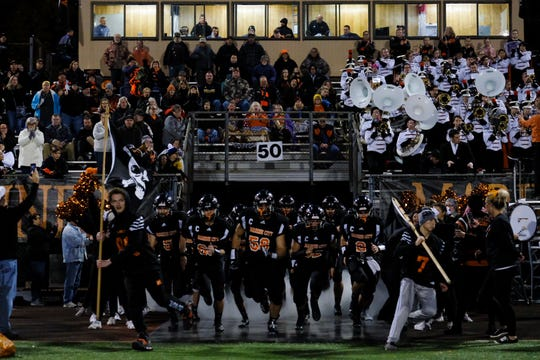 The Marine City football teams takes the field against Warren Lincoln during a non-conference game on Friday, Oct. 25, 2019, at East China Stadium.