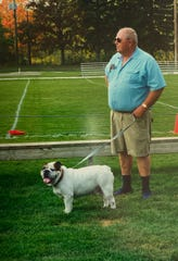Larry Vesper with Admiral, the pet bulldog he took to many Yale Public Schools sporting events.