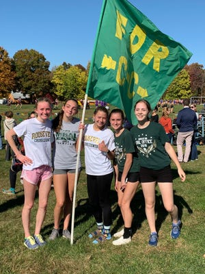 Members of the Franklin D. Roosevelt girls cross country team pose after winning the Mid-Hudson Athletic League title on Oct. 24.