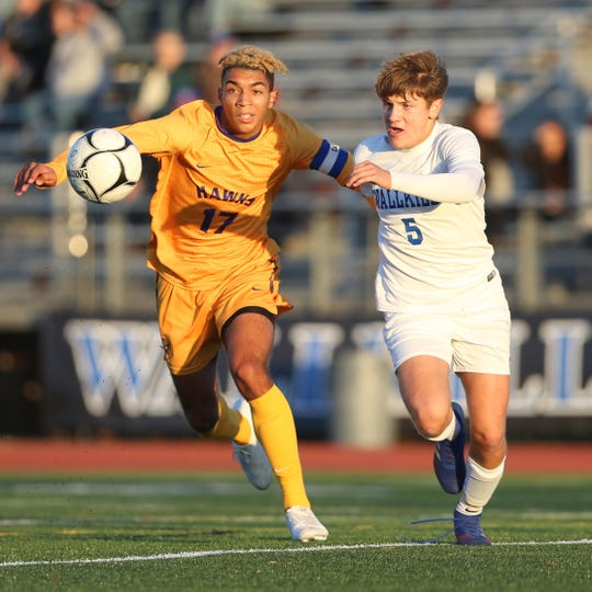 Rhinebeck's Nakoa Zuger and Wallkill's Chad Castle sprint after the ball during the MHAL boys soccer championship in Wallkill on October 24, 2019.