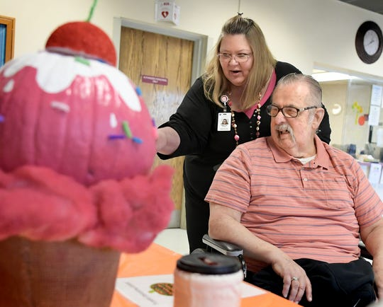 Pleasant Acres Nursing and Rehabilitation Center administrator Tamitha Hetrick looks at resident-created Halloween pumpkins on display with resident Paul Stambaugh, formerly of York Springs, at the center Thursday, October 24, 2019. The facility was privatized when Premier Healthcare Management purchased it from York County in October of 2018. Bill Kalina photo