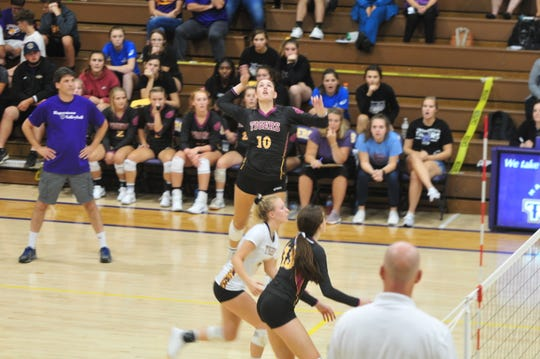 Senior outside hitter Regan Tinkle (10) leads the Tri-Eastern Conference in kills (388), hitting percentage (.541) and kills per set (4.6).