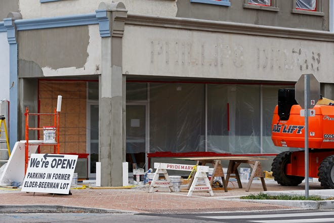 Work continues on the new facade for Phillips Drugs, 631 E. Main St. in Richmond, on Friday, Oct. 25, 2019.