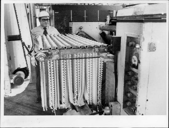 A rack of fresh noodles comes out of the dough machine at Bravo Macaroni Co. in 1977.