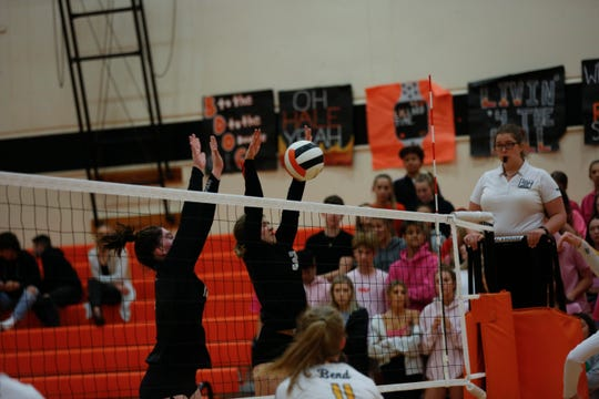 Sprague's Hannah Blubaugh, 10, and Lily Albrecht, 3, make a play at the net during the Sprague Olympians and Bend Lava Bears volleyball game at Sprague High School in Salem, Oct. 24, 2019.