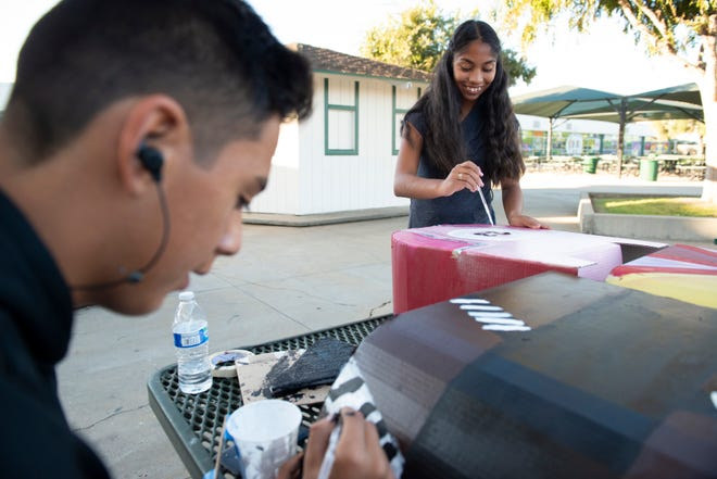Alisal High School students paint their finsihing touches to the costume projects they have been working during class for the Magic Wheelchair program on Friday, Oct. 25, 2019.