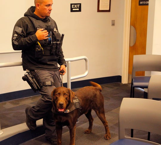 "Zachary Dunagan and his police dog ""Oakley"" were present at a press conference on the Violence Suppression Task Force's summer campaign in which the unit seized hundreds of prescription pills and street drugs."