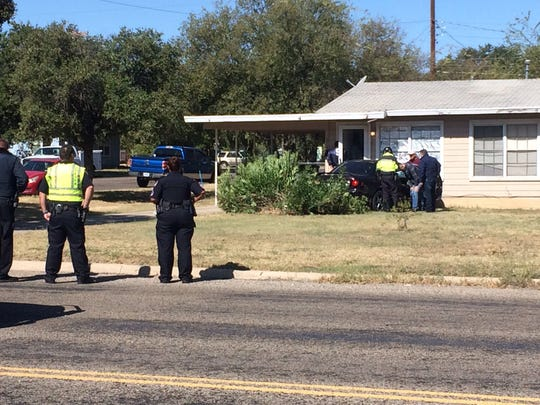 San Angelo police respond to a crash involving a vehicle and a house at South Campus Boulevard and West Beauregard Avenue on Oct. 25, 2019.