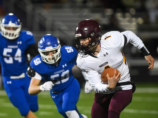 Madison quarterback and defensive back Tyler Tappe (1) runs the ball during the game against Sioux Falls Christian on Thursday, Oct. 24, 2019 at Bob Young Field.