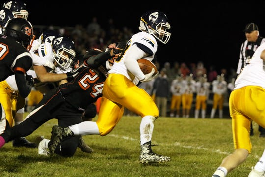 JT Panning of Tea Area runs the ball as Coby Maeschen of Dell Rapids attempts to make the tackle during Friday night's game in Dell Rapids.