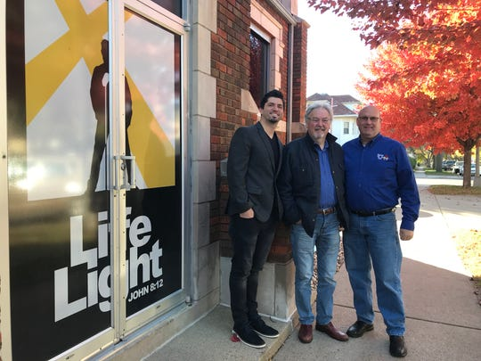 Giving Hope founder Neil Hlebichuk (far right) stands for a portrait in front of LifeLight headquarters at 420 S. Duluth Ave. in Sioux Falls with LifeLight CEO Josh Brewer (far left) and Robin Byrne, executive director of the Sioux Empire Community Theatre.