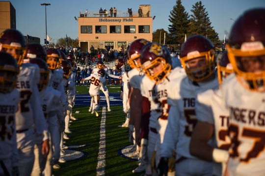 Harrisburg football players run out onto the field during the game against O'Gorman on Thursday, Oct. 24, 2019 at McEneaney Field.