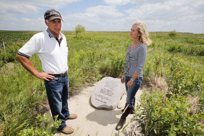 Jon Hoffman, left, talks about the day of the crash as he and his wife, Carla, visit the memorial marking the spot on some of their farmland near Mina where a private airplane carrying professional golfer Payne Stewart and five others crashed 20 years ago.