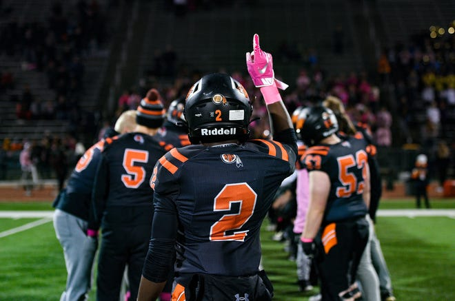 Freddy Frederic of Washington greets fellow players as they are introduced before their game against Roosevelt on Thursday, October 24, at Howard Wood Field in Sioux Falls.