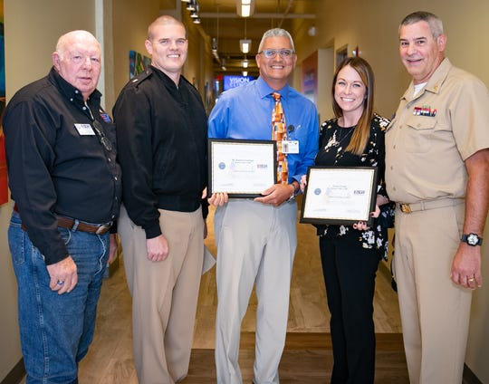 From left are retired Lt. Col. John Salchow; Lt. Cmdr. Jason Moody, commanding officer; Dr. Rafael Santiago with Jordan Valley Community Health Center; Tracie Grube, also with the health center; and Brady Stark, Jordan Valley physician assistant and nominating Guard member, chief petty officer with the U.S. Navy Reserve Unit.