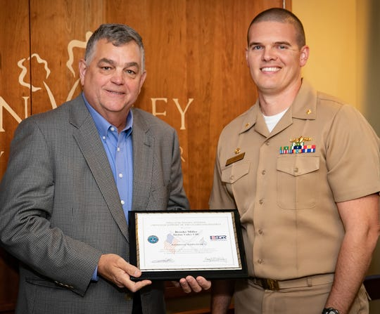 Pictured are Jordan Valley Community Health Center CEO Brooks Miller and Lt. Cmdr. Jason Moody.