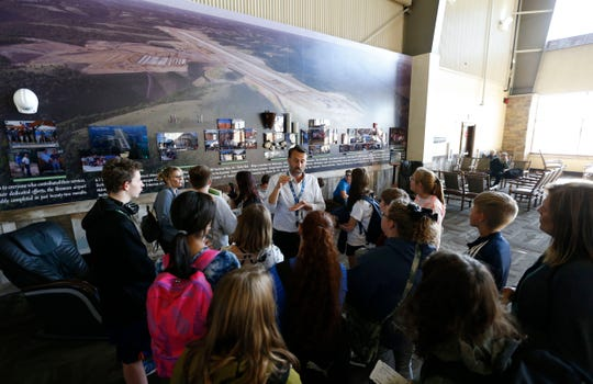 Ty Lewis, deputy director of marketing for the Branson Airport, talks to Hollister School students about the construction of the airport during a tour of the airport on Wednesday, Oct. 23, 2019.