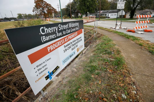"A ""Progress as Promised"" sign at Cherry Street and Barnes Avenue."