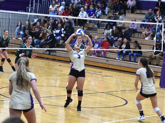Waynesboro's Cierra Bruce sets the ball Thursday during her team's match with Broadway.