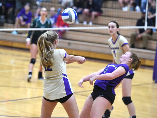 Waynesboro's Amber Witry makes a pass while teammate Paige Smith works to stay out of her way during the Valley District Tournament opening round Thursday.