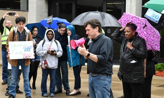 Aric Putnam speaks on the St. Cloud State University campus on Oct. 1, 2019, during a march and rally to protest planned faculty layoffs there. Putnam is a professor at the College of St. Benedict and St. John's University and is running for state Senate in 2020.