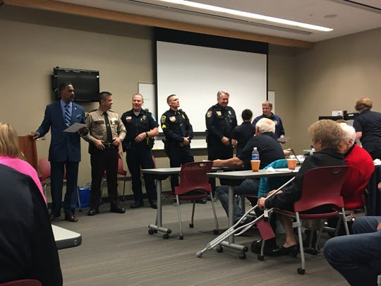 Police chiefs  from local law enforcement agencies hand out certificates of completion at the Metro Citizens Police Academy on Oct. 24, 2019, at the St. Cloud Police Department.