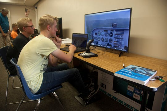 Dixie High School student Russell Mathews operates a flight simulator Wednesday, Oct. 23, 2019.