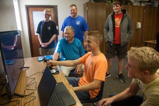 Dixie High School student Alex Eggers operates a flight simulator as classmates and instructors observe Wednesday, Oct. 23, 2019.