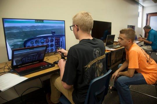 Dixie High School student Quinn Glacier operates a flight simulator Wednesday, Oct. 23, 2019.