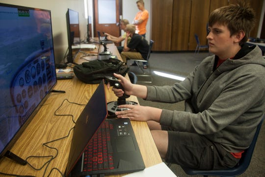 Dixie High School student Noah Hall operates a flight simulator Wednesday, Oct. 23, 2019.