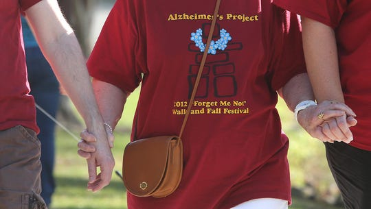 Some  walked arm in arm during a previousAnnual Forget-Me-Not Walk to benefit the Alzheimer's Project