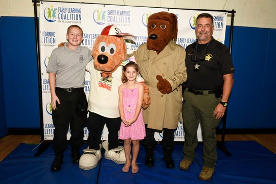 Jayden B., Brady Sledizie as Scruffy, Leila S., Lucas Sledezie as McGruff and Britt Reynolds attend the Early Learning Coalition's KIDMania at Minsky Gym and Whispering Pines Park in Port St. Lucie.