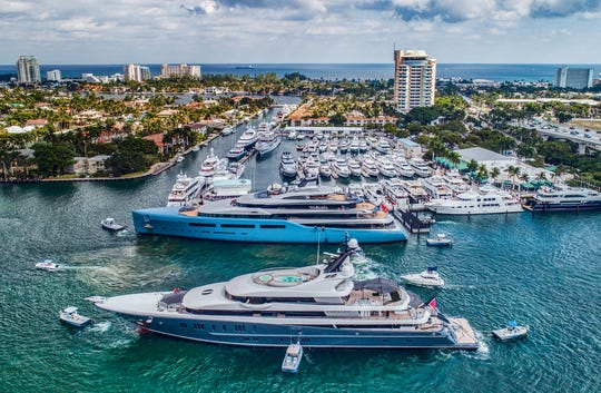 Superyachts are being maneuvered into position prior to the Fort Lauderdale International Boat Show which runs Oct. 30-Nov. 3.