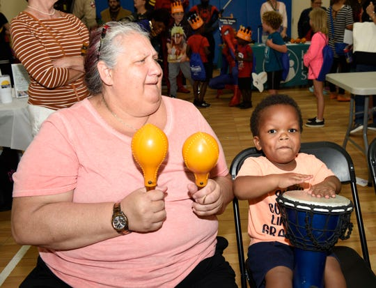 Luann Benack and Landon S. make music at the Early Learning Coalition's KIDMania at Minsky Gym and Whispering Pines Park in Port St. Lucie.