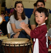 Taka S. keeps the beat at the Early Learning Coalition's KIDMania at Minsky Gym and Whispering Pines Park in Port St. Lucie.