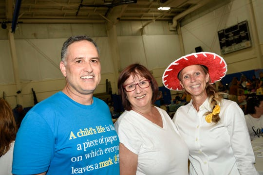 Early Learning Coalition of St. Lucie County Executive Director Tony Loupe, left, County Commissioner Linda Bartz and Kimberly Roberts at KIDMania at Minsky Gym and Whispering Pines Park in Port St. Lucie.