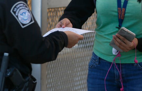 CBPO Elda Alfaro checks identification at the U.S. Customs and Border Protection Bridge of the Americas Port of Entry Friday, Oct. 25, in El Paso.