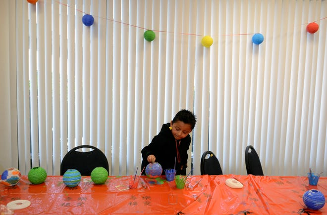 A boy participates in a project at the La Colonia Branch Library in this 2013 file photo. The neighborhood library was destined for closure but remains open due to fundraising.