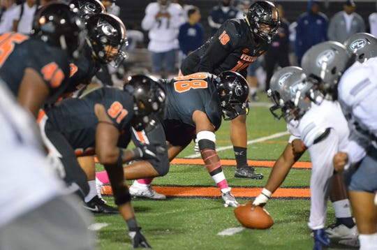 Former Grace Brethren defensive end Dassani Freeman (19, top) has played both inside and outside for the Ventura College defensive line as a sophomore.