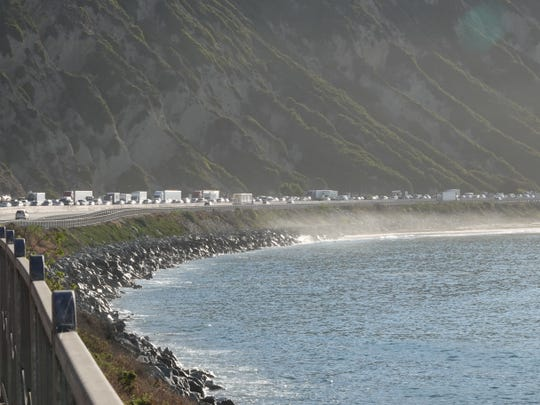 Northbound Highway 101 traffic was jammed Friday morning, as seen from Mussel Shoals, due to an emergency pothole repair in Carpinteria that reduced the route to one lane.