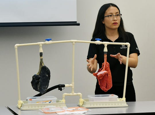 A California Health Collaborative representative demonstrates the damage prolonged vape and tobacco use can do to lung health to dozens of Visalia students on Oct. 24, 2019.
