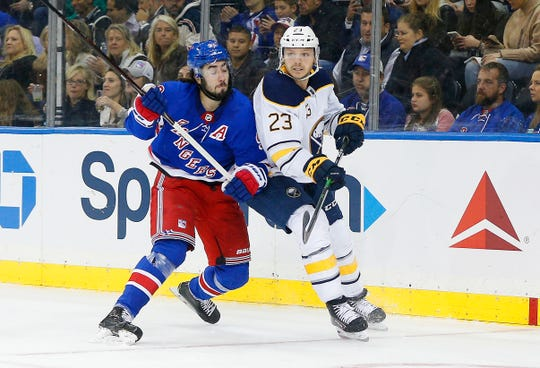Oct 24, 2019; New York, NY, USA; Buffalo Sabres center Sam Reinhart (23) and New York Rangers center Mika Zibanejad (93) battle for position during the second period at Madison Square Garden. Mandatory Credit: Andy Marlin-USA TODAY Sports