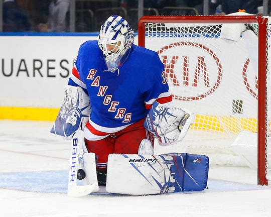 Oct 24, 2019; New York, NY, USA; New York Rangers goaltender Henrik Lundqvist (30) makes a save against the Buffalo Sabres during the third period at Madison Square Garden. Mandatory Credit: Andy Marlin-USA TODAY Sports