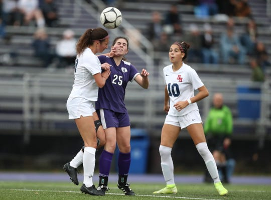 John Jay-Cross River's Catherine Labrolia (25) works for a header against Byram Hills' Victoria Ganeles (19) during their 3-1 win in the first round of girls soccer playoffs at John Jay High School in Cross River on Friday, October 25, 2019.