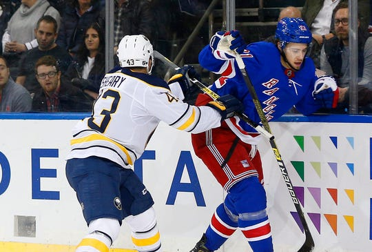 Oct 24, 2019; New York, NY, USA; New York Rangers center Brett Howden (21) and Buffalo Sabres left wing Conor Sheary (43) come together at the boards during the first period at Madison Square Garden. Mandatory Credit: Andy Marlin-USA TODAY Sports