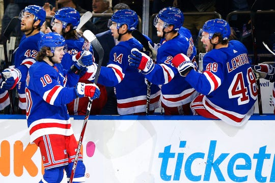 Oct 24, 2019; New York, NY, USA; New York Rangers center Artemi Panarin (10) is congratulated after scoring a goal against the Buffalo Sabres  during the first period at Madison Square Garden. Mandatory Credit: Andy Marlin-USA TODAY Sports