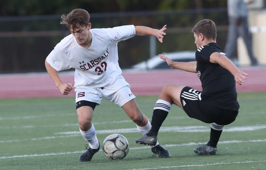 White Plains defeated Scarsdale 4-1 in PKs in boys soccer playoff action at White Plains High School Oct. 24, 2019.